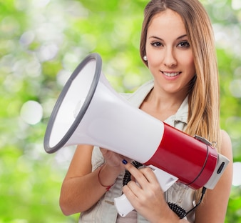 Woman smiling with a megaphone