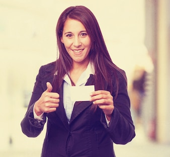 Woman smiling with a thumb up and a business card