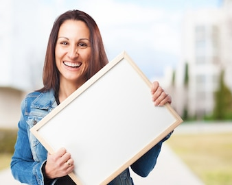 Woman smiling with a white board