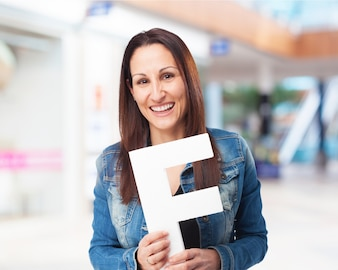 Woman smiling with letter  f