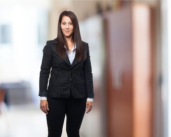 Woman standing with jacket suit