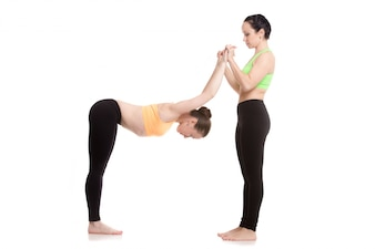 Woman stretching arms of another woman