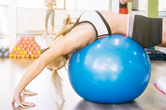 Woman stretching her back on fitball