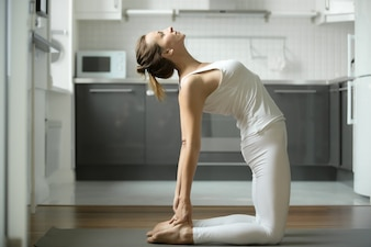 Woman stretching in Camel exercise