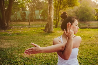 Woman stretching in the nature with the sunset