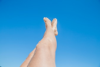 Woman stretching legs towards the sky