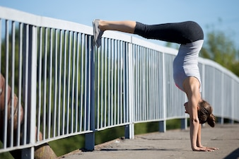 Woman stretching with feet on the railing