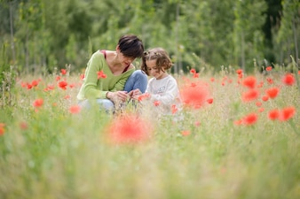 Woman talking about flowers to her daughter