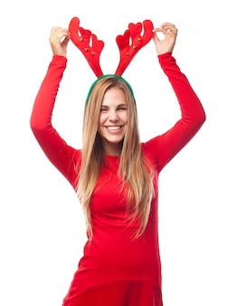 Woman touching her reindeer antlers