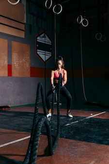 Woman training with rope