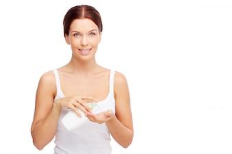 Woman using liquid soap