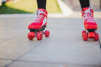 Woman wearing rollerskates riding on pavement