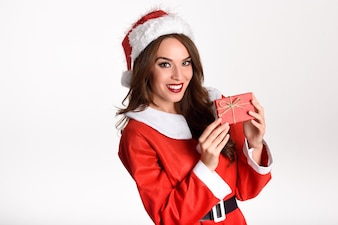 Woman wearing santa claus clothes with a gift box