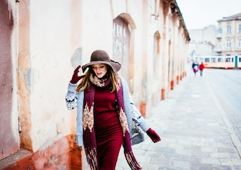 Woman wearing warm clothing walking outside