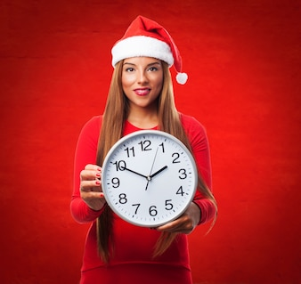 Woman with a big clock in a red background