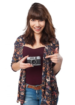 Woman with a book and a photo camera
