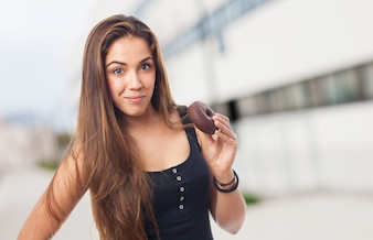 Woman with a chocolate donut
