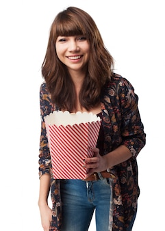 Woman with a packet of popcorn