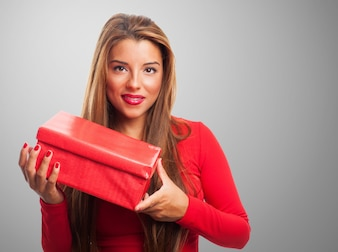 Woman with a red box in a gray background