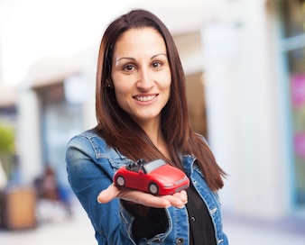 Woman with a red car