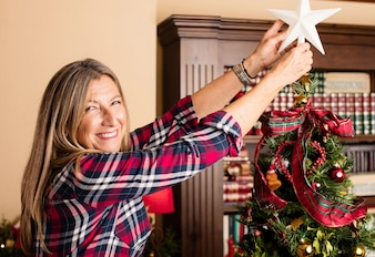 Woman with a star and a chiristmas tree