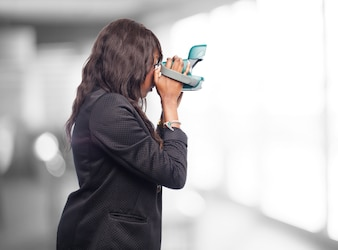 Woman with an instant camera