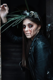 Woman with bloody eyes makeup