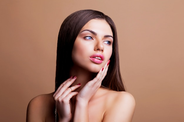 Woman with dark straight hair and sexy lips posing