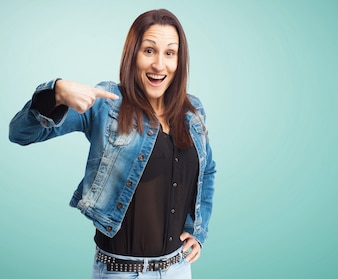 Woman with denim jacket pointing at herself