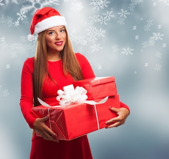Woman with gift boxes on christmas background