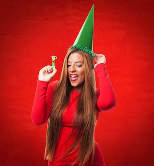 Woman with green hat in a red background
