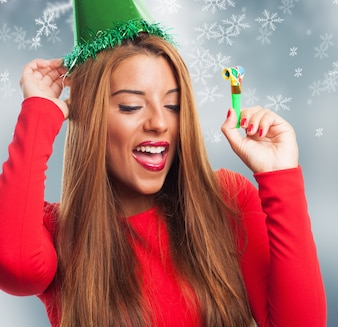 Woman with green hat in a snowflakes background