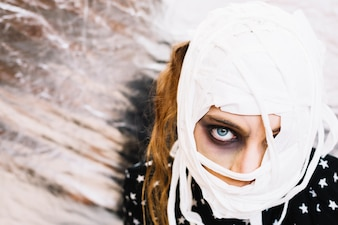 Woman with head wrapped in bandage