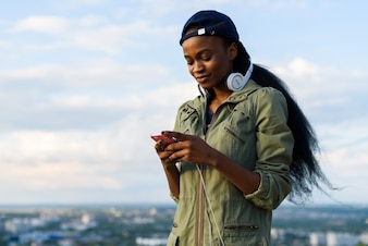Woman with headphones and a smartphone