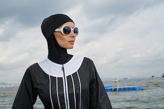 Woman with headscarf and sunglasses
