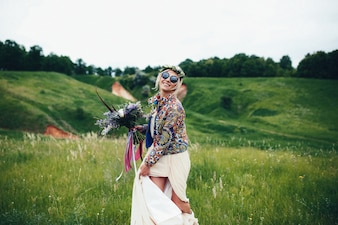 Woman with hippie clothes in the field