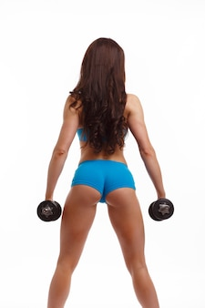 Woman with long hair and weights