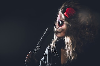 Woman with painted face for the carnival