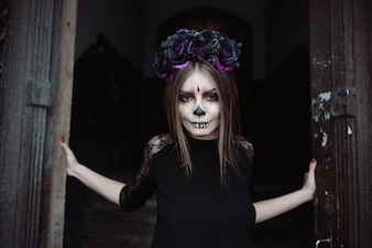Woman with scaryface paint for Halloween