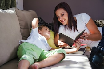 Woman with son reading books