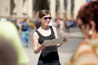 Woman with sunglasses looking at a map