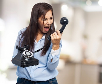 Woman yelling at the phone