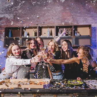 Women clinking glasses of champagne together