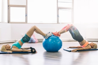 Women doing exercises with fitball