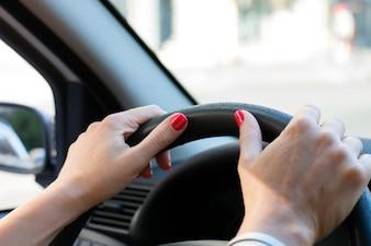 Women driving car - driving fast