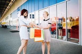 Women exchanging paper bags