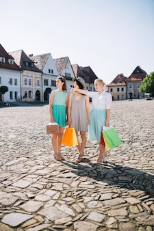 Women looking at pointed location