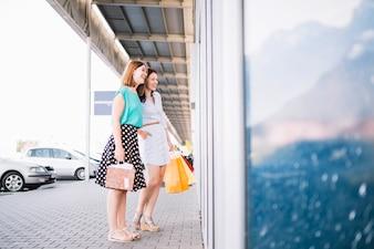 Women looking at shop-window