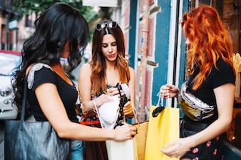 Women showing each other purchased things