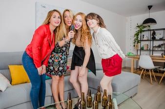 Women singing in karaoke